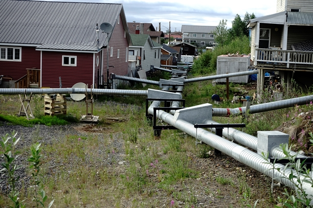 THE SERVICE PIPES IN INUVIK HAVE ALMOST AN ARTISTIC APPEAL. THEY ARE ABOVE GROUND DUE TO THE PERMAFROST.
